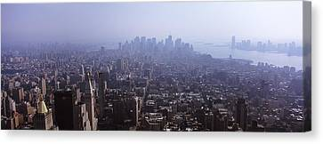High Angle View Of Buildings In A City Canvas Print by Panoramic Images