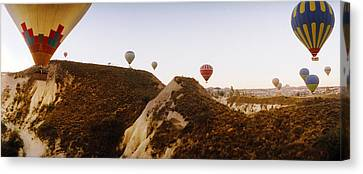Enjoyment Canvas Print - Hot Air Balloons Over Landscape by Panoramic Images