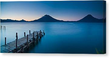 Jetty In A Lake With A Mountain Range Canvas Print by Panoramic Images