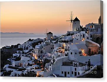 Oia Town During Sunset Canvas Print by George Atsametakis