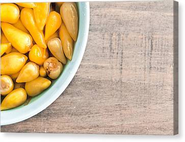 Wooden Bowl Canvas Print - Pickled Peppers by Tom Gowanlock
