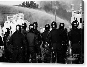 Psni Riot Officers Behind Armoured Land Rover And Water Cannon On Crumlin Road At Ardoyne Shops Belf Canvas Print