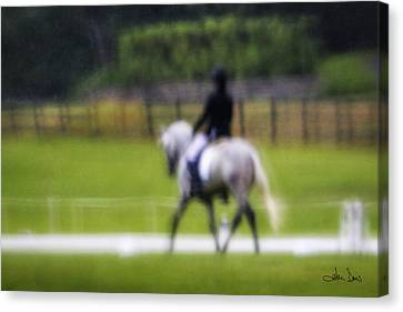Canvas Print featuring the photograph Rainy Day Dressage by Joan Davis