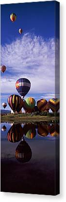 Air Travel Canvas Print - Reflection Of Hot Air Balloons by Panoramic Images