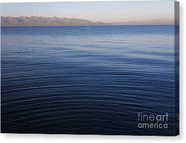 Kyrgyzstan Canvas Print - Ripples On The Surface Of Lake Song Kul In Kyrgyzstan by Robert Preston