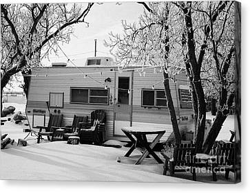 small trailer mobile home covered in snow in rural village of Forget Saskatchewan Canada Canvas Print by Joe Fox