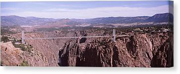 Suspension Bridge Across A Canyon Canvas Print by Panoramic Images
