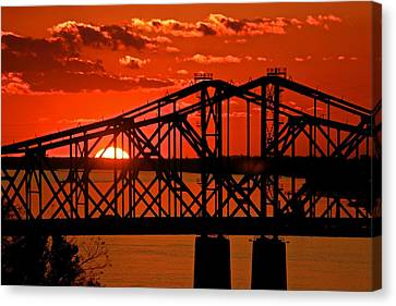 The Mississippi River Bridge At Natchez At Sunset.  Canvas Print by Jim Albritton