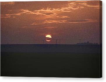 The Setting Sun In The Distance With Clouds Canvas Print