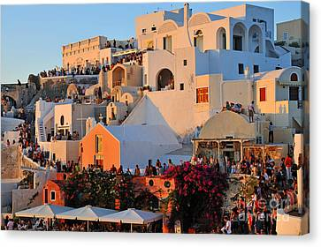 Waiting For The Sunset In Oia Town Canvas Print by George Atsametakis