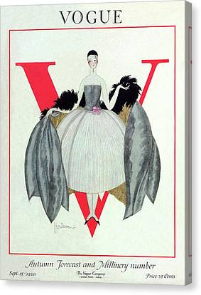 A Vogue Magazine Cover Of A Woman Canvas Print by Georges Lepape