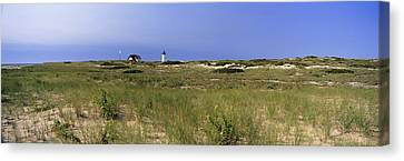 Beach With Lighthouse Canvas Print by Panoramic Images