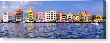 Multi Colored Canvas Print - Buildings At The Waterfront by Panoramic Images
