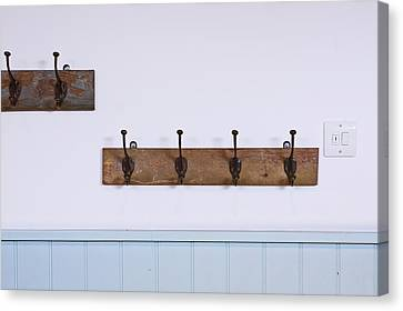 Coat Hooks Canvas Print by Tom Gowanlock