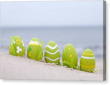 Easter Decorated Eggs On Sand Canvas Print by Michal Bednarek