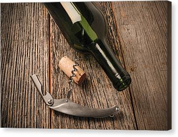 Wine Glass Canvas Print - Green Wine Bottle And Cork With Red Wine And Corkscrew by Brandon Bourdages