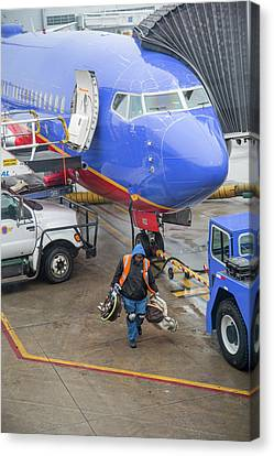 Ground Crew Worker At Chicago Airport Canvas Print by Jim West