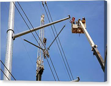 High Voltage Power Line Construction Canvas Print by Jim West
