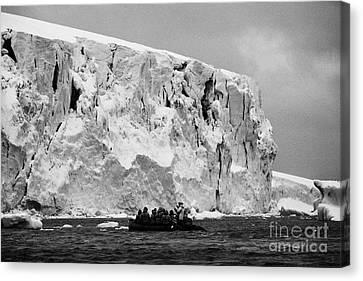icebergs and glacier on cuverville island Antarctica Canvas Print