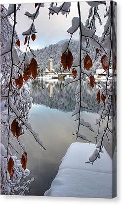 Lake Bohinj In Winter Canvas Print by Ian Middleton
