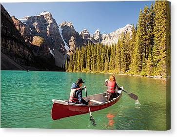 Moraine Lake In The Canadian Rockies Canvas Print by Ashley Cooper