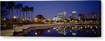 Reflection Of Buildings In Water Canvas Print
