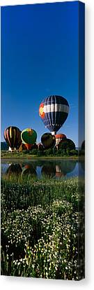 Reflection Of Hot Air Balloons Canvas Print by Panoramic Images