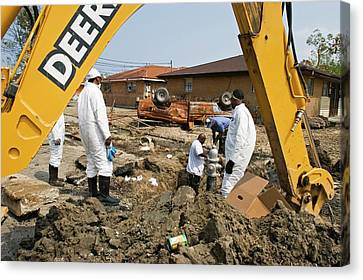 Repairing Hurricane Katrina Damage Canvas Print by Jim West