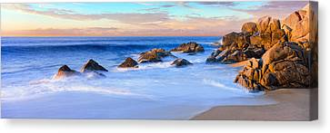 Rock Formations On The Beach Canvas Print by Panoramic Images