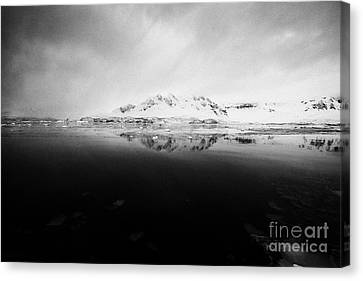 snow covered landscape in Fournier Bay on Anvers Island Antarctica Canvas Print by Joe Fox
