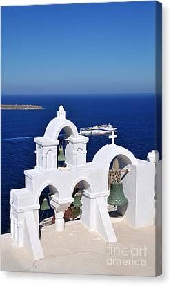 Traditional Belfry In Oia Town Canvas Print by George Atsametakis