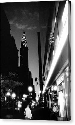 Canvas Print featuring the photograph 42nd-street-dawn by Dave Beckerman