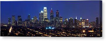 Built Canvas Print - Buildings Lit Up At Night In A City by Panoramic Images