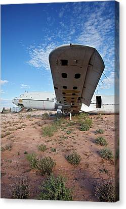 Military Aircraft In Salvage Yard Canvas Print by Jim West