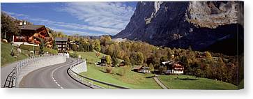 Road Passing Through A Landscape Canvas Print by Panoramic Images