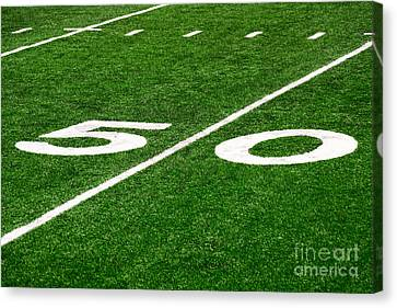 50 Yard Line On Football Field Canvas Print by Paul Velgos