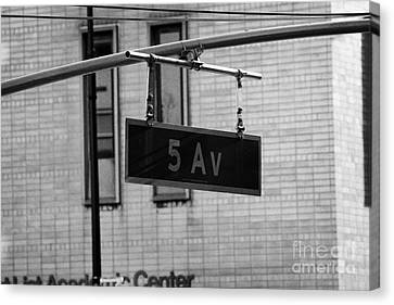 Manhatten Canvas Print - 5th Avenue Ave Road Traffic Sign Hanging From Overhead Pole New York by Joe Fox