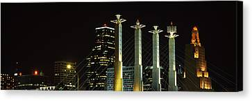 Buildings Lit Up At Night In A City Canvas Print by Panoramic Images
