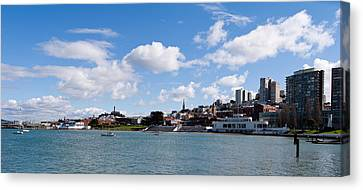Skyscrapers At The Waterfront Canvas Print by Panoramic Images
