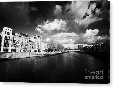 Halfpenny Bridge Canvas Print - View Of The River Liffey And Hapenny Bridge Dublin Republic Of Ireland by Joe Fox