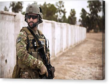 A Coalition Force Member Maintains Canvas Print by Stocktrek Images