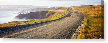 Dirt Road Passing Through A Landscape Canvas Print by Panoramic Images