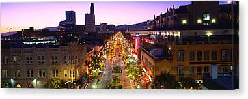 High Angle View Of A City Lit Canvas Print