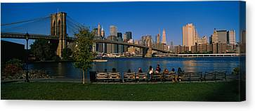 Suspension Bridge Across A River Canvas Print by Panoramic Images