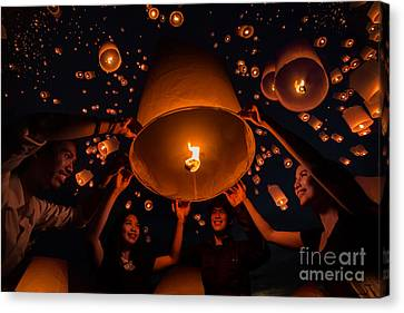 Thai People Floating Lamp Canvas Print by Anek Suwannaphoom