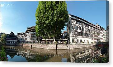 Rhin Canvas Print - Reflection Of Buildings On Water by Panoramic Images