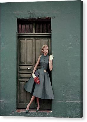 Textile Canvas Print - A 1950s Model Standing In A Doorway by Leombruno-Bodi
