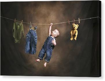 A Baby On The Clothesline Canvas Print by Pete Stec