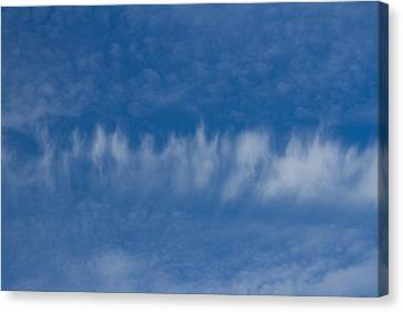Canvas Print featuring the photograph A Batch Of Interesting Clouds In A Blue Sky by Eti Reid
