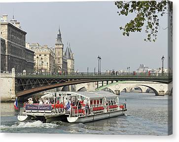 A Bateaux Cruises On The Seine River Canvas Print by William Sutton